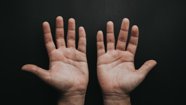 Left and right hand with palms showing