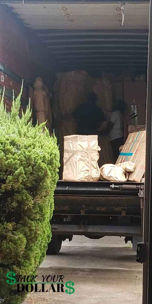 Movers loading truck for pcs